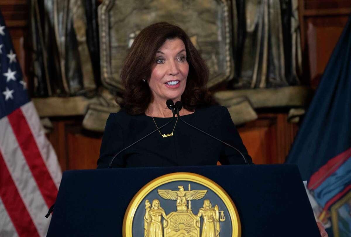 """Gov. Kathy Hochul wears a """"vaxed"""" necklace as she holds a COVID-19 briefing at the Capitol on Tuesday, Oct, 5, 2021 in Albany, N.Y."""