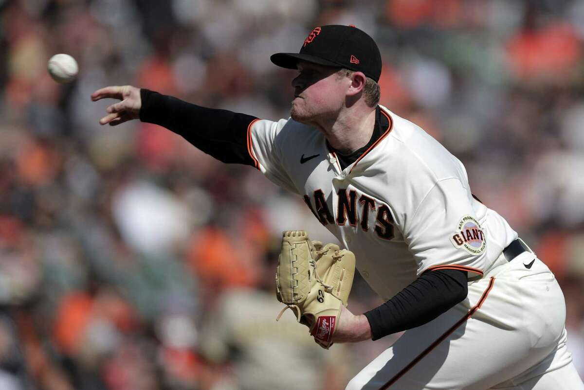 Logan Webb (62) pitches in the first inning as the San Francisco Giants played the San Diego Padres at Oracle Park in San Francisco, Calif., on Sunday, October 3, 2021.