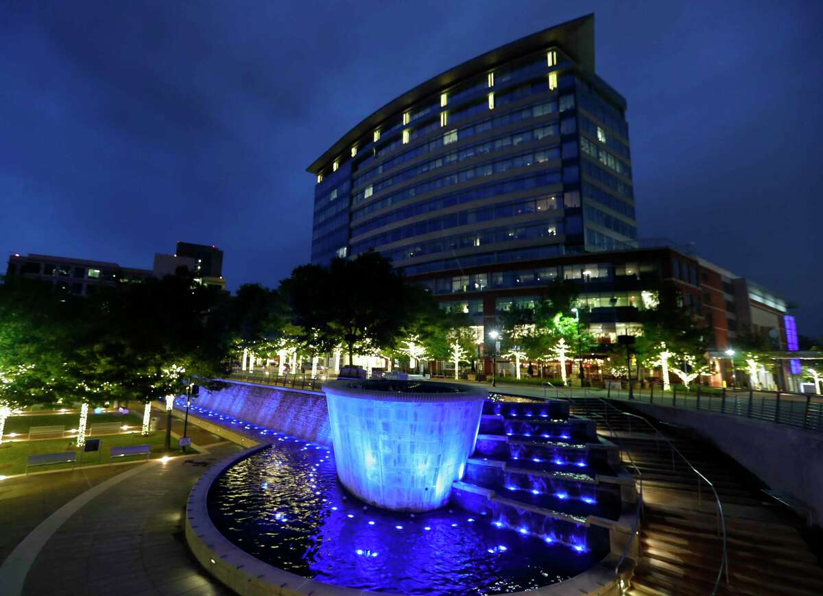 The Woodlands Waterway Square is lit up in light blue Friday, April 17, 2020, in The Woodlands, The lights are part of the global Light It Blue movement to support healthcare workers in the ongoing coronavirus pandemic.