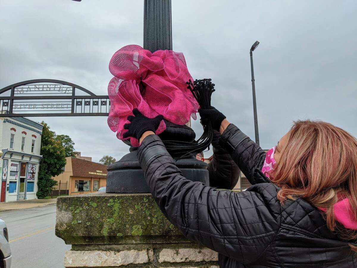 In this file photo, apink bow is hung in downtown Manistee last October.As it was last year, this year's Paint the Town Pinkevent has been canceled by Munson Healthcare Manistee Hospital due to the coronavirus pandemic. (Courtesy photo)