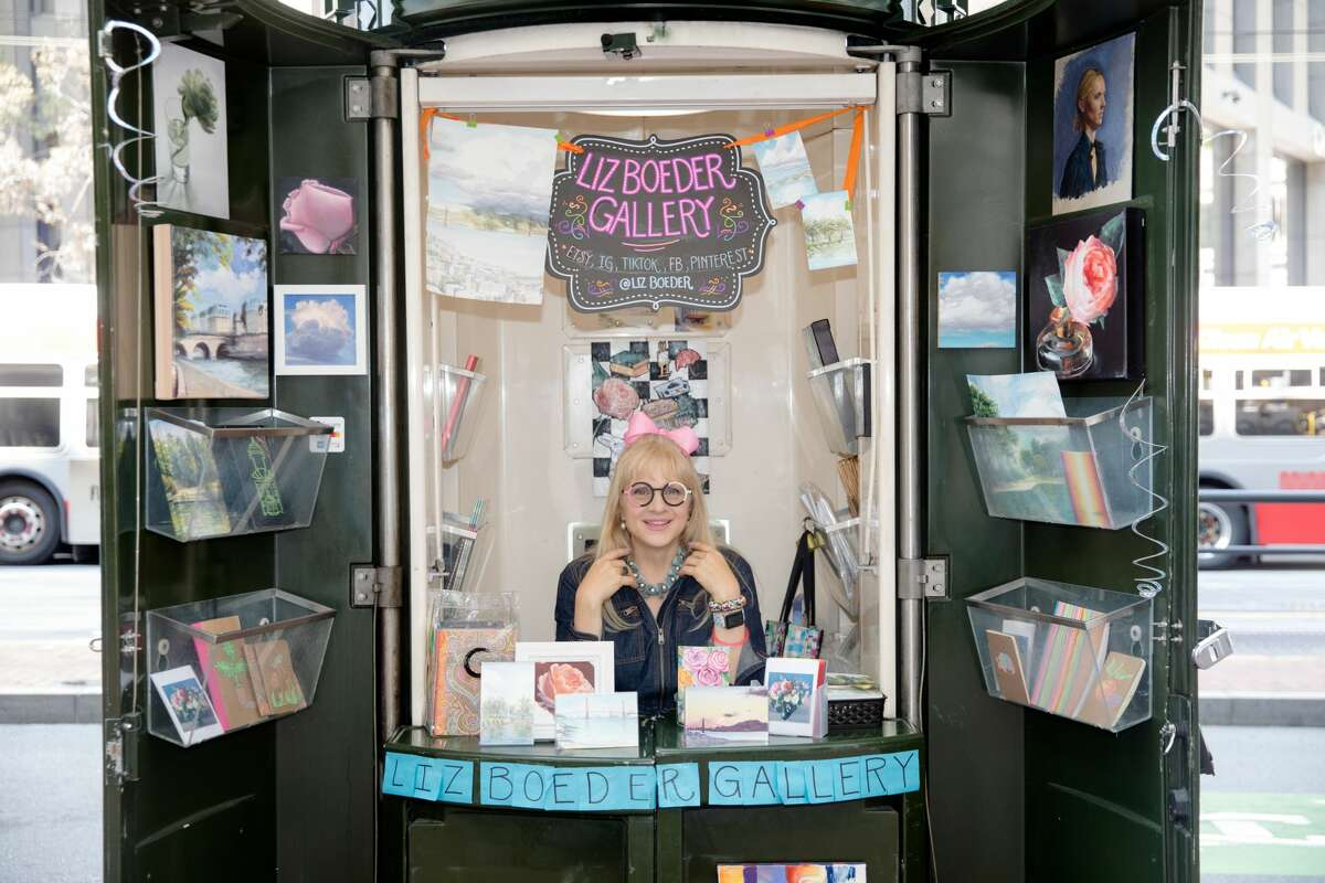Artist Liz Boeder has turned an old newspaper kiosk into a street art gallery on Market Street near New Montgomery Street in San Francisco on Oct. 4, 2021. The project is a joint effort by the San Francisco Arts Commission and JCDecaux, owners of the kiosks, to breathe new life into the kiosks across downtown.
