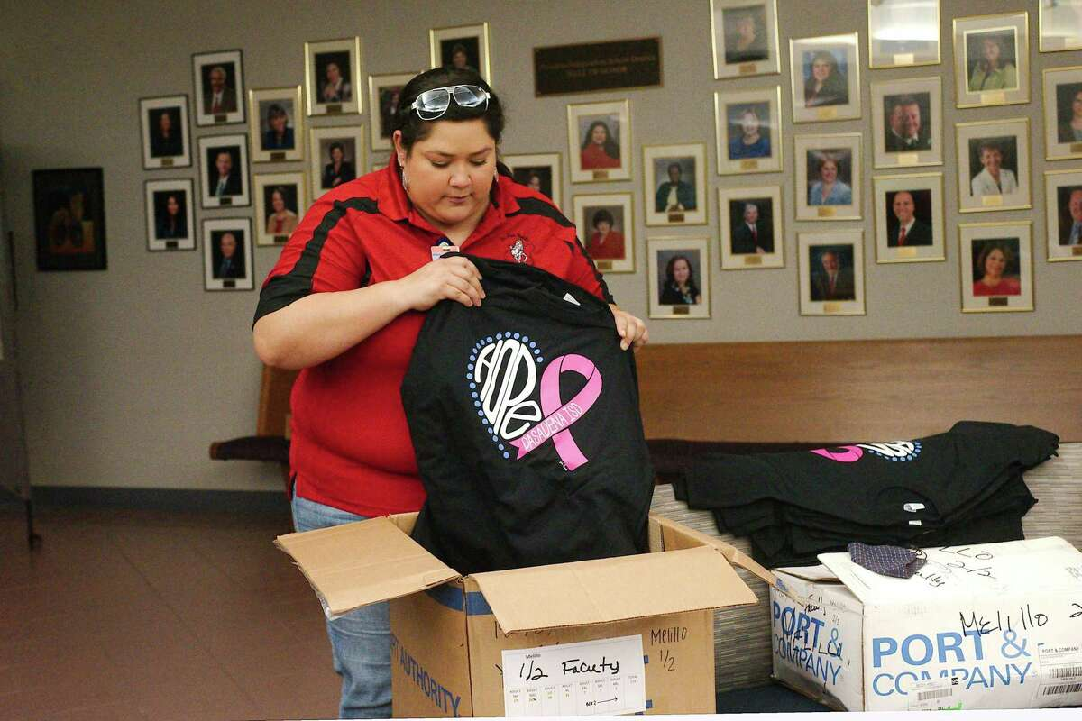 Melillo Middle School science instructional coach Rebecca Castaneda examines her school's T-shirt order for the annual Pasadena ISD Komen Campaign to raise funds to fight breast cancer.
