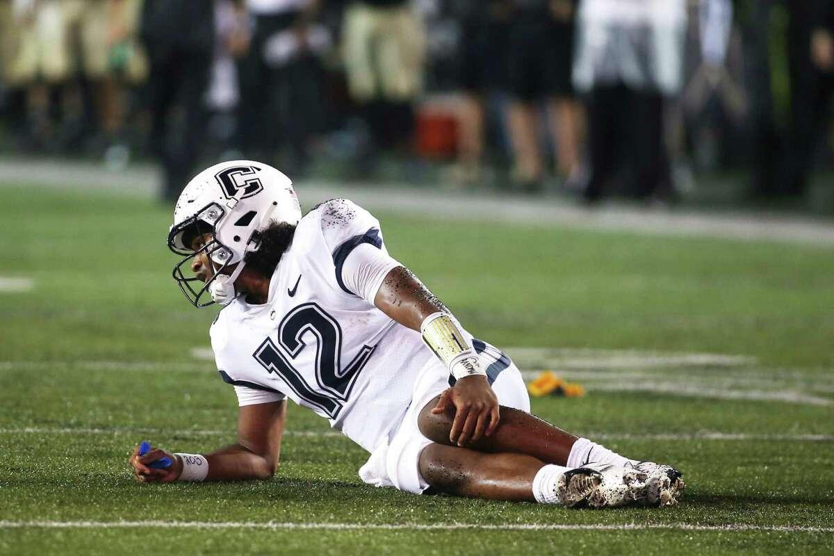 UConn QB Tyler Phommachanh holds his leg after suffering an injury at Vanderbilt on Saturday in Nashville.