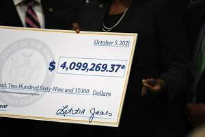 New York State Attorney General Tish James presents a check to Albany County which the state received from settlements reached with drug manufacturers and distributors accused of fueling the opioid crisis on Tuesday, Oct. 5, 2021, during a press conference at Albany Medical Center in Albany, N.Y.