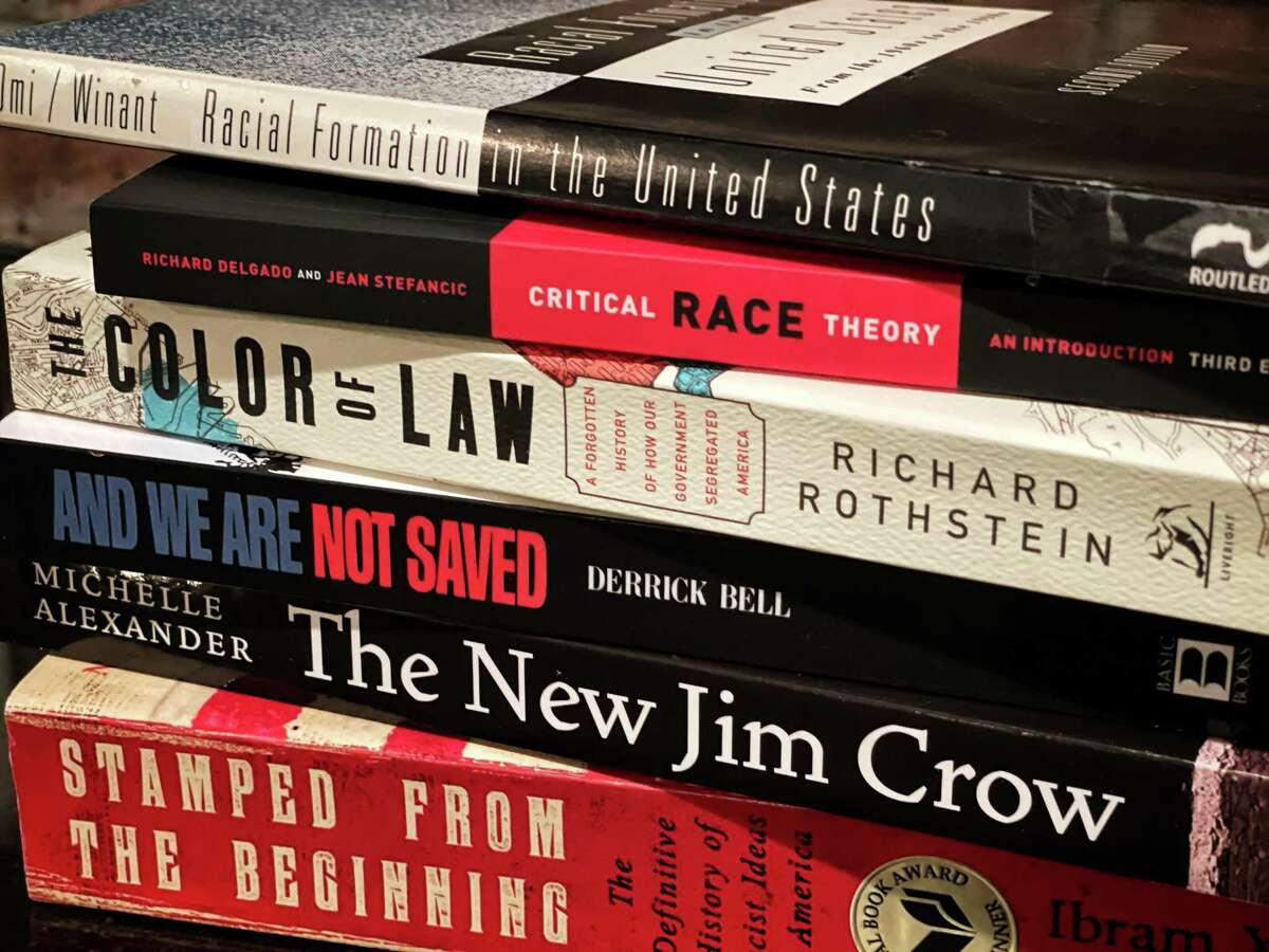 """This July 2021 photo shows several of the books commonly assigned in college and law school courses focused on critical race theory. The once-obscure academic discipline has emerged as a flashpoint in political debates, with Republicans in Texas and other states passing legislation to ban the teaching of critical race theory or """"CRT"""" in public schools."""