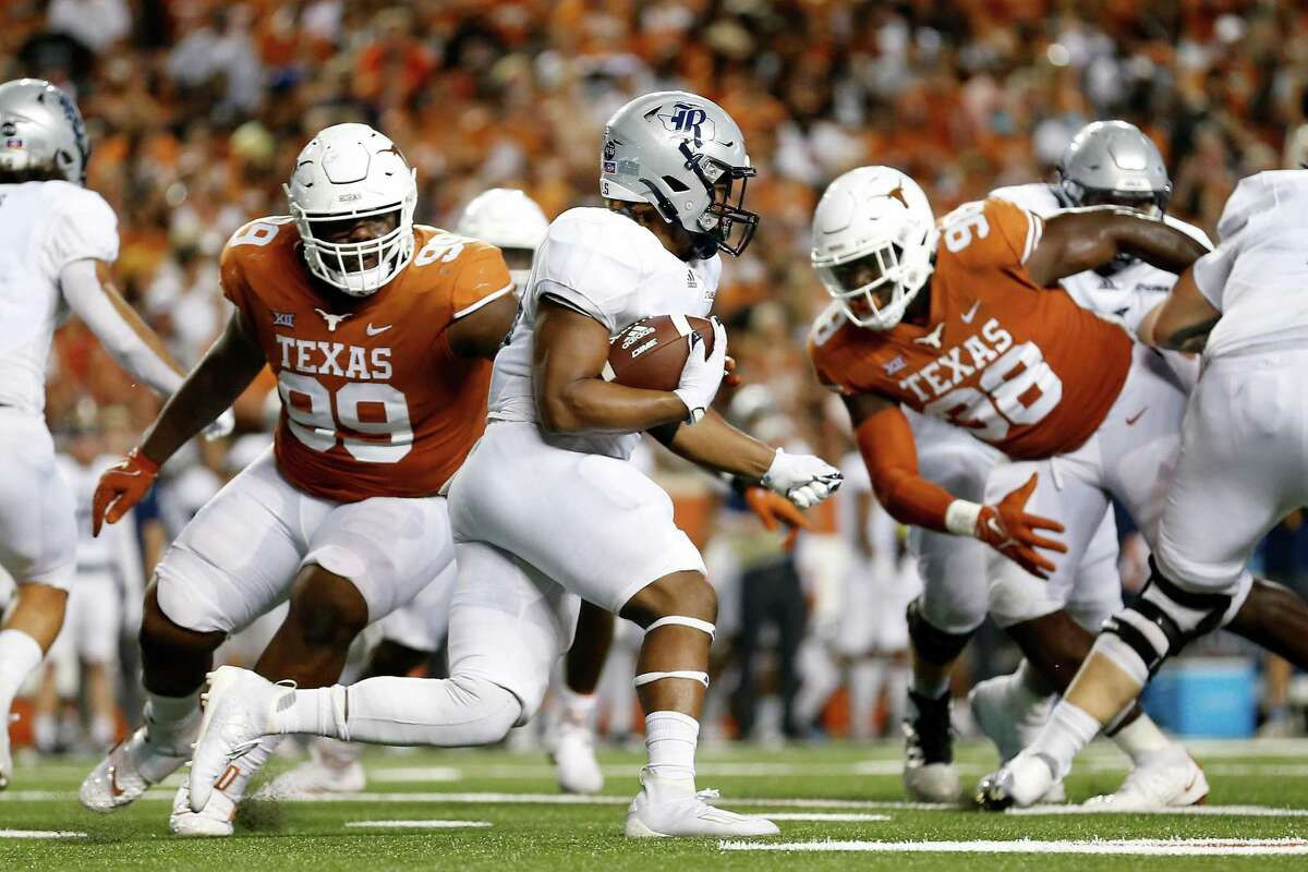 Ari Broussard #30 of the Rice Owls runs the ball in the second half against the Texas Longhorns at Darrell K Royal-Texas Memorial Stadium on September 18, 2021 in Austin, Texas.