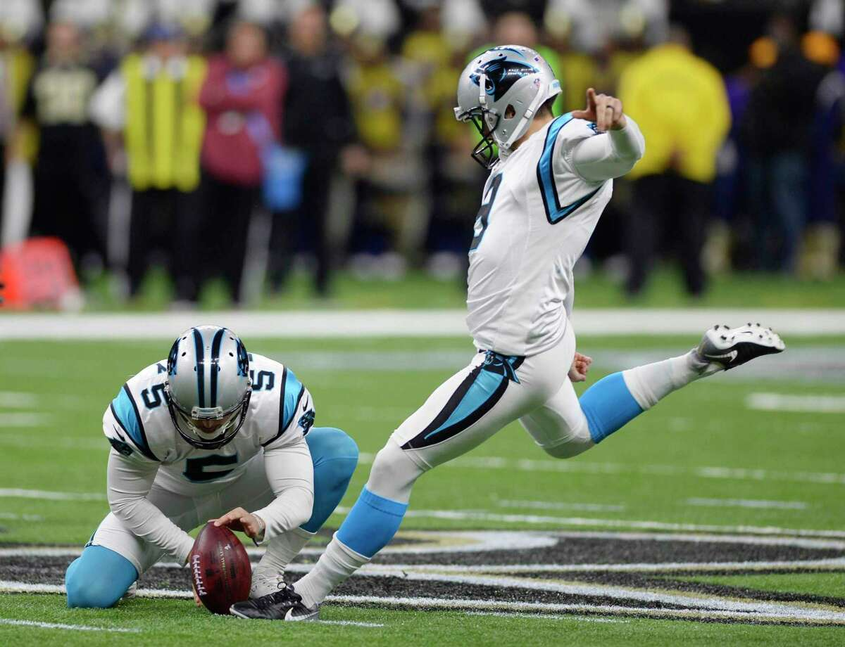 Carolina Panthers kicker Graham Gano (9) connects on a 58-yard field goal as punter Michael Palardy (5) holds against the New Orleans Saints during the first half in their NFC Wild Card playoff game on Sunday, January 7, 2018 at the Mercedes-Benz Superdome in New Orleans, La. The Panthers released Gano on Thursday after eight seasons with the team. (David T. Foster III/The Charlotte Observer/TNS)