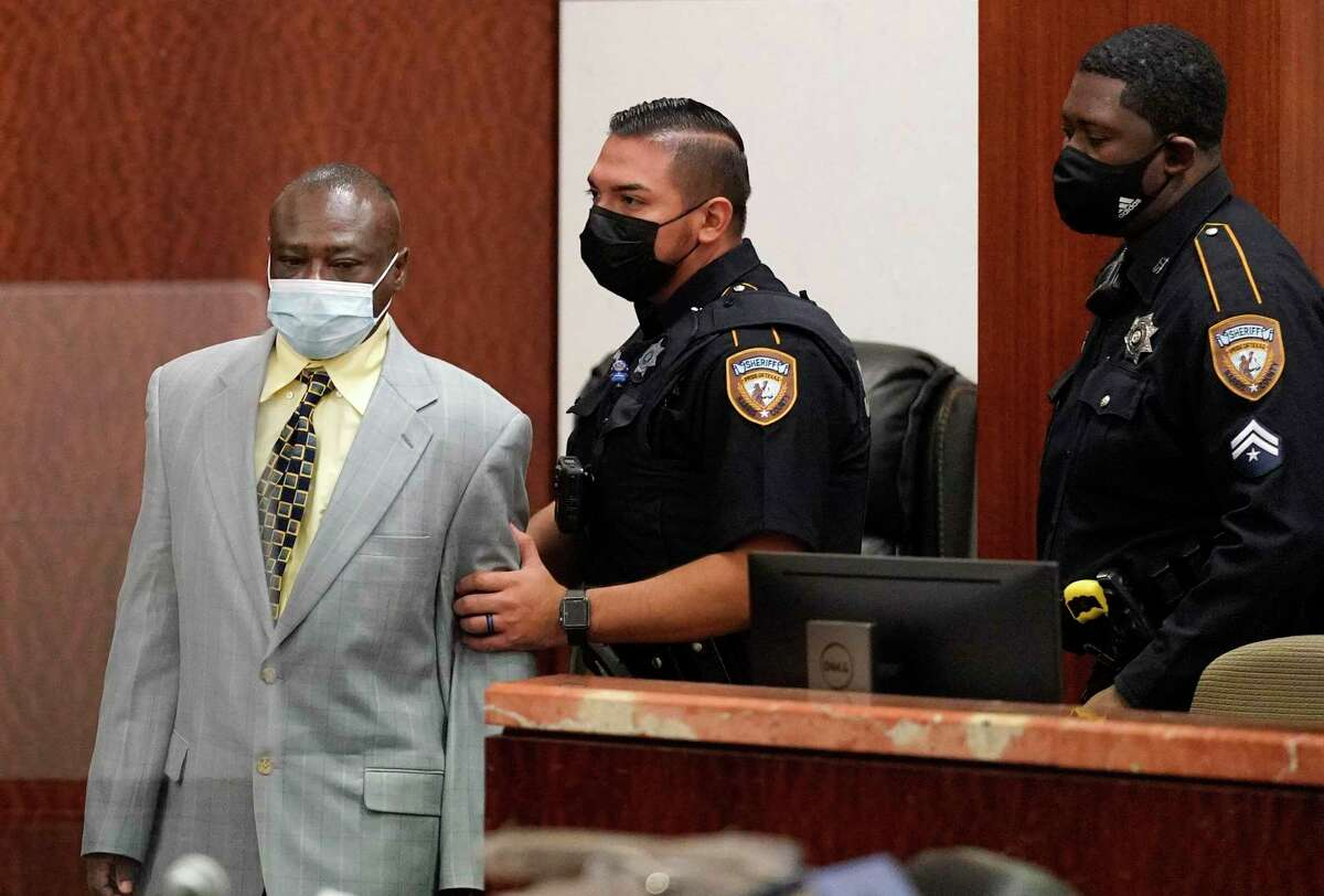 David Conley is escorted into the Harris County Criminal Court of Judge Chuck Silverman during his trial Tuesday, Oct. 5, 2021 in Houston for the murders of eight people. Valerie Jackson, her husband, Dwayne Jackson, and six children Nathaniel, 13, Honesty, 11, Dwayne Jr., 10, Caleb, 9, Trinity, 7, and Jonah, 6, were killed on on Aug. 8, 2015. Prosecutors are not seeking the death penalty.