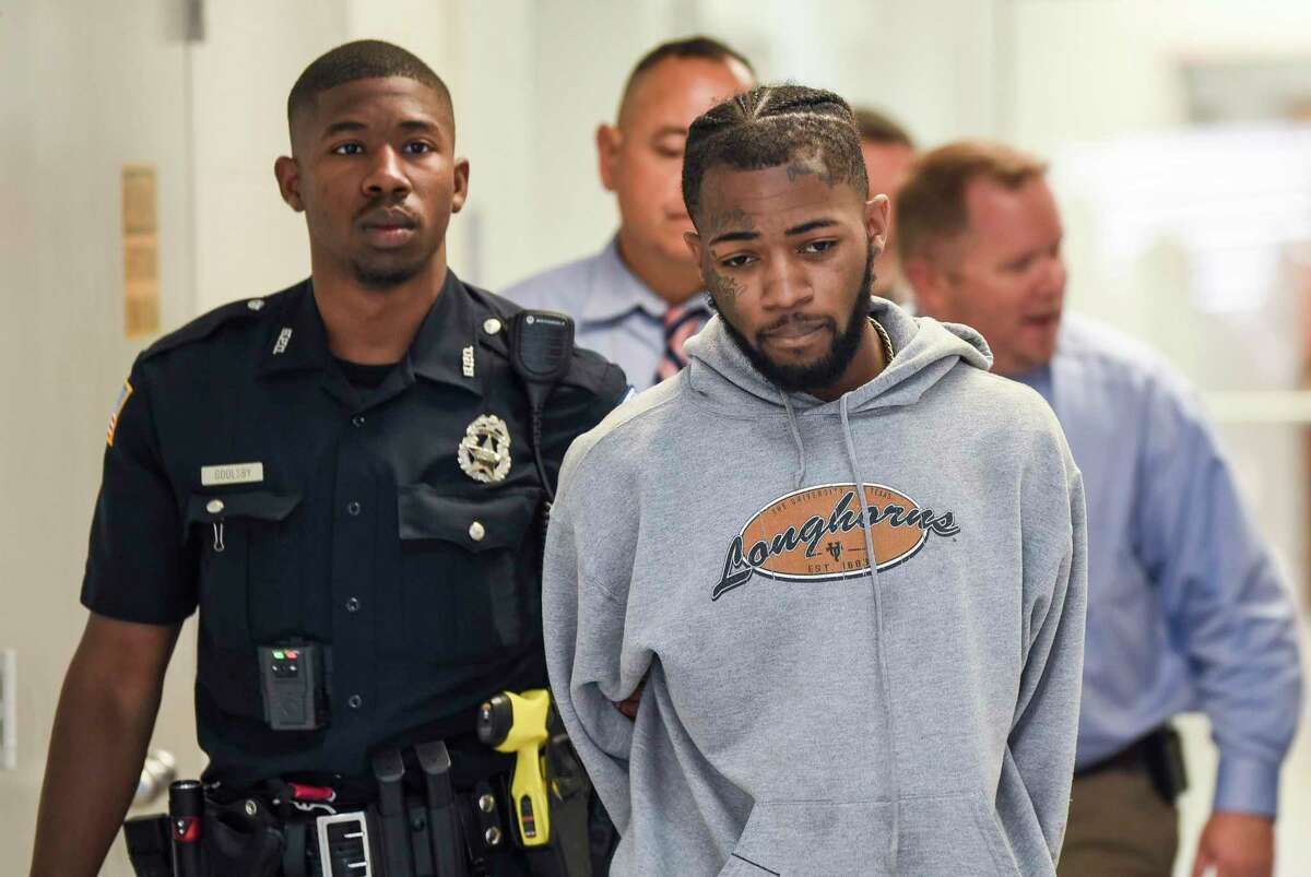 Demarcus Micah Williams, a 19 year old Port Arthur resident, is walked from the Beaumont Police Department to a waiting police car. He is being charged with capital murder with bond set at $5 million. Photo taken on Friday, 05/24/19. Ryan Welch/The Enterprise