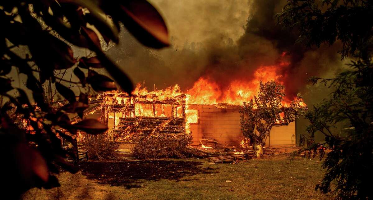Flames consume a house near Old Oregon Trail as the Fawn Fire burned north of Redding in Shasta County. Alexandra Souverneva, the Palo Alto woman charged with lighting the fire, will undergo a psychological evaluation after her attorney cast doubt on her ability to help him defend her in court.