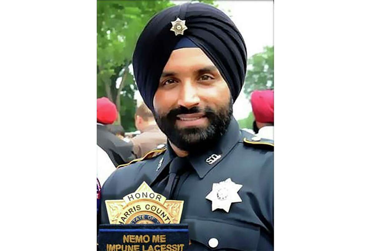 This photo provided by Harris County Sheriff's office shows Deputy Sandeep Dhaliwal. Dhaliwal was shot and killed while making a traffic stop Friday, Sept. 27, 2019 near Houston. Robert Solis, 47, of Houston, was charged with capital murder in the slaying. (Harris County Sheriff's office via AP)