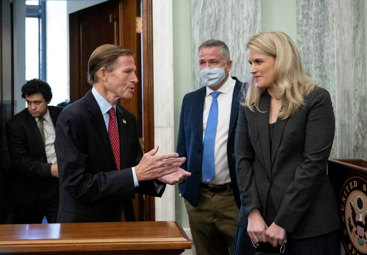 Sen. Richard Blumenthal, D-Conn., speaks with former Facebook employee and whistleblower Frances Haugen as she arrives to testify before a Senate Committee on Commerce, Science, and Transportation hearing on Capitol Hill on Tuesday.