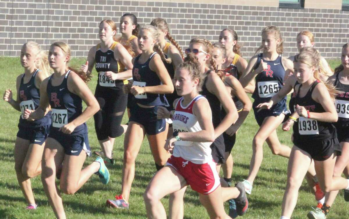 Big Rapids, Chippewa Hills and Reed City girls and other CSAA Gold runners start the cross country race on Tuesday at BRHS. (Pioneer photo/John Raffel)