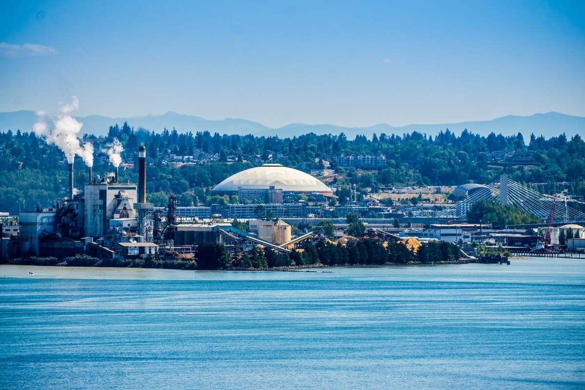 Steam rises from a factory near the Tacoma Dome in Tacoma, Washington.