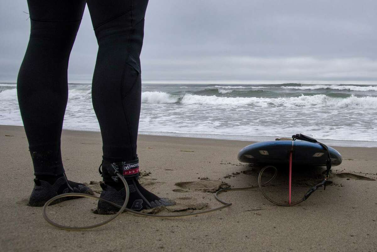 Phillip Leone of Sebastopol prepares to go surfing at North Salmon Creek Beach after it was reopened. A surfer was bitten by a shark two days earlier, prompting closure of the beach.