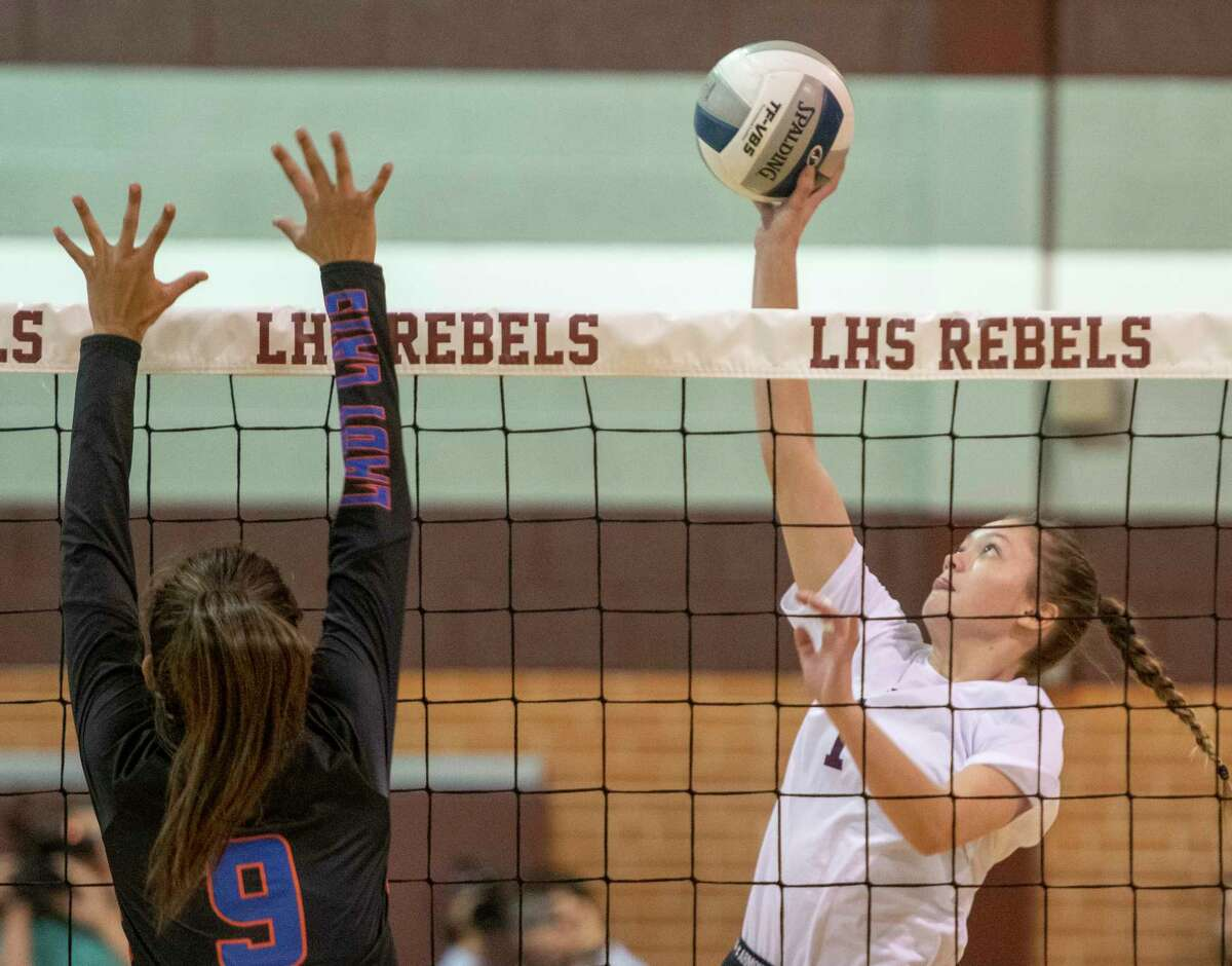 Legacy High's Kylee Radwanski looks to tip the ball past the reach of San Angelo Central's Julia Morales 10/05/2021 at Legacy High gym. Tim Fischer/Reporter-Telegram