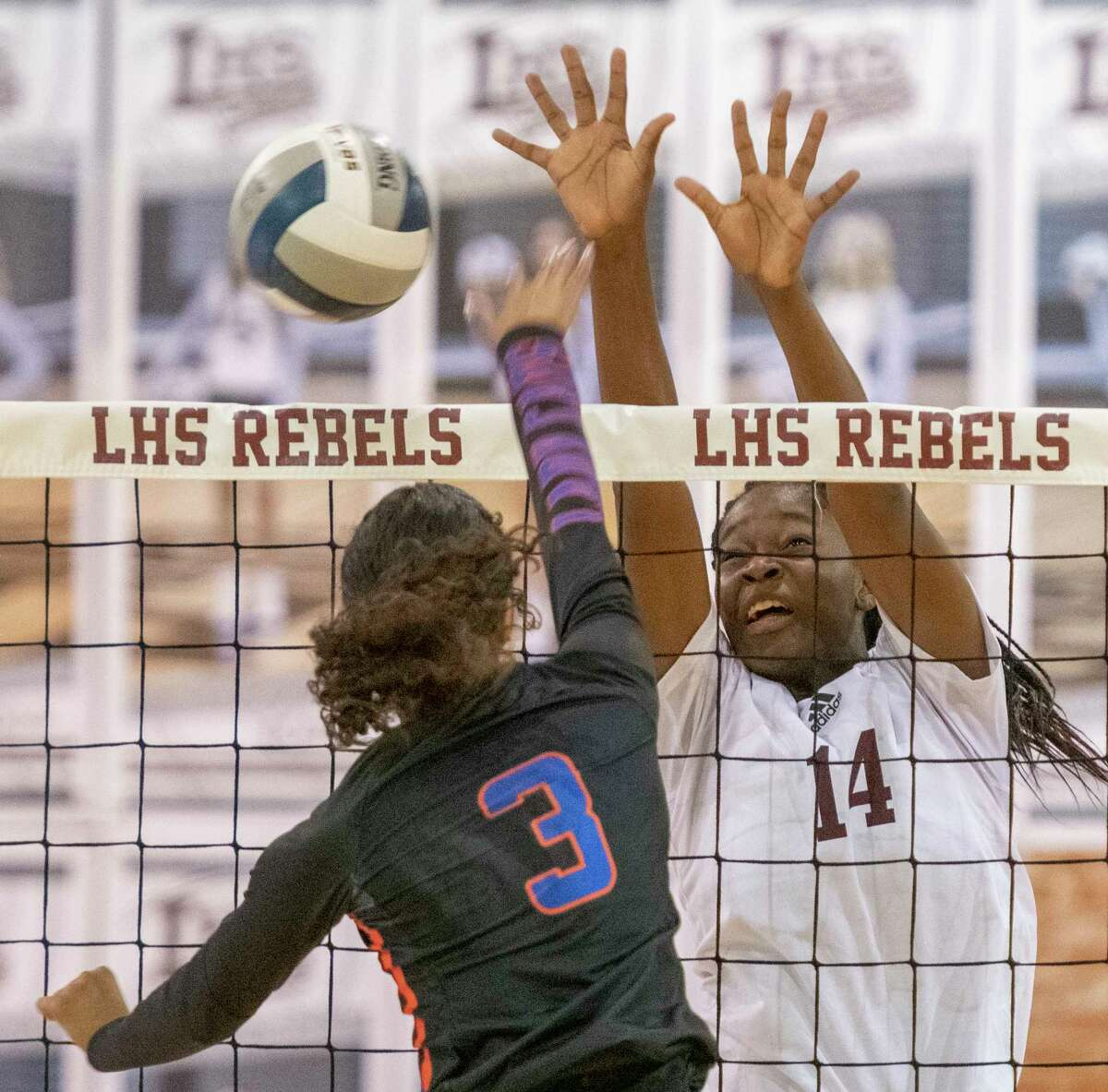 San Angelo Central's Peyton Mayberry hits the ball away from the block of Legacy High's Loredana Fouonji 10/05/2021 at Legacy High gym. Tim Fischer/Reporter-Telegram