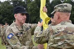New York Guard Brig. Gen. Peter Riley, left, accepts the colors of the New York Guard from Maj. Gen. Ray Shields, state adjutant general, during a change of command at Camp Smith Training Site near Peekskill.