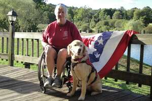 Karen Smith is pictured with her former service dog, Ginger, at Lyman Orchards.