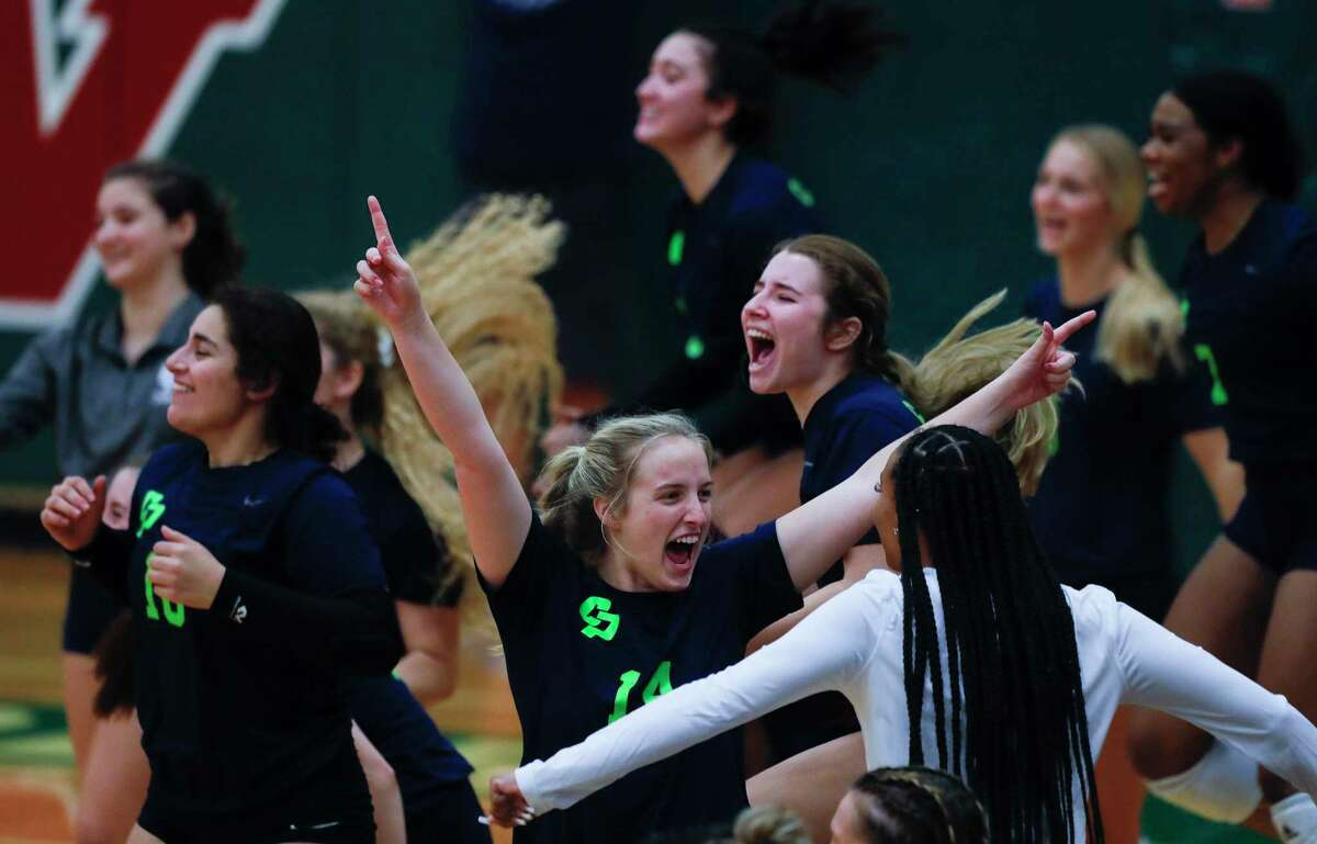 College Park's Kinsee Bieser (14) reacts with players after a point during the fourth set of a high school volleyball match at The Woodlands High School, Tuesday, Oct. 5, 2021, in The Woodlands.