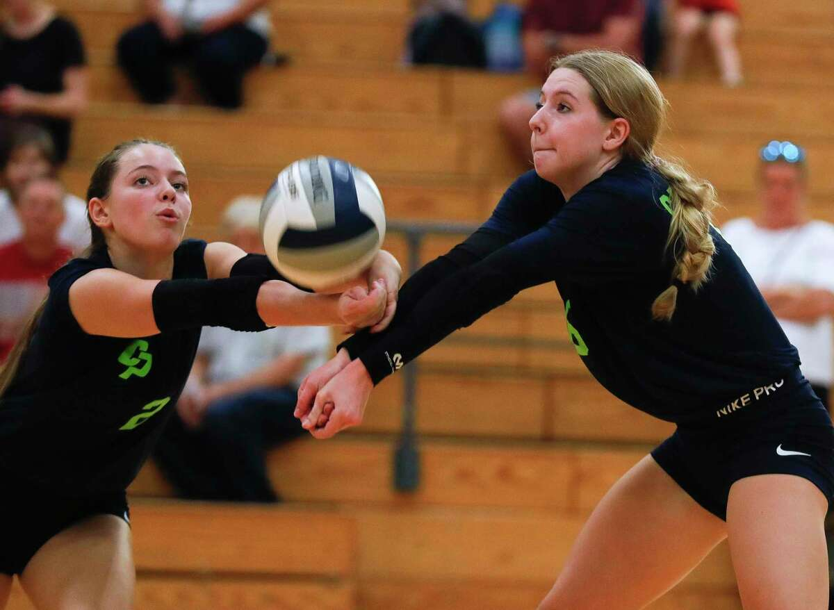 College Park's Morgan Madison (2) and Mallory Madison (6) collide while returning a hit during the first set of a high school volleyball match at The Woodlands High School, Tuesday, Oct. 5, 2021, in The Woodlands.