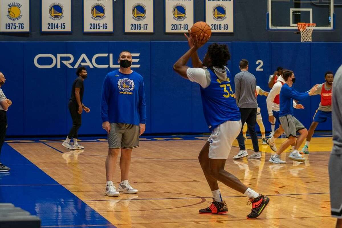 Warriors player-development coach Dejan Milojevic, shown above working with James Wiseman at a recent practice, has a proven track record of maximizing promising young big men's potential.