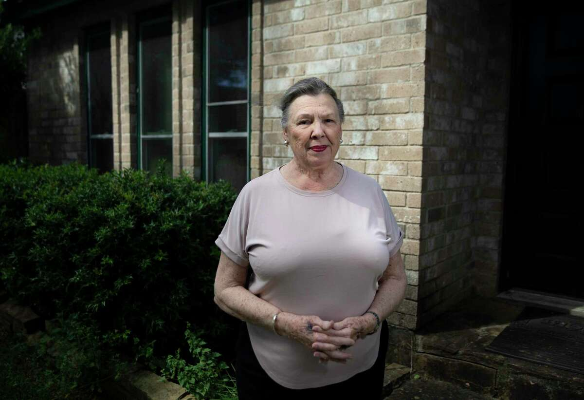Beverly Smith, 80, poses for a photograph outside her house Wednesday, Sept. 22, 2021, in Houston. Smith suffered excruciating back pain that prevented her from standing up for more than 10 minutes at a time. But Dr. Nadya Dhanani performed an innovative radiofrequency ablation procedure, which uses radiofrequency waves to deaden the small nerve endings in the spine and block the signal of pain, on Smith and she said the pain has reduced significantly.