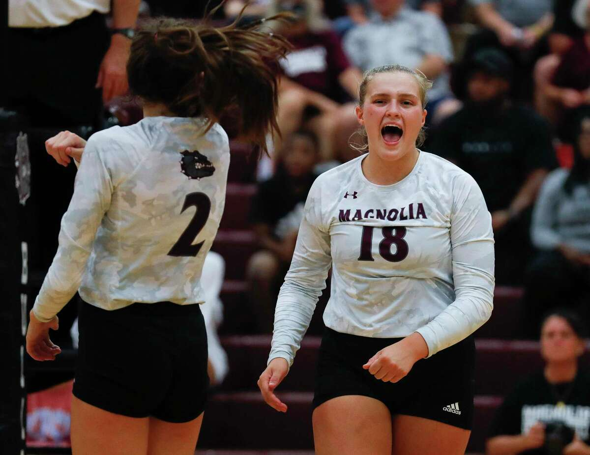 Magnolia middle blocker Brynn Botkin (18), shown here earlier this season, had 17 kills and 19 digs in a win over Brenham on Tuesday.