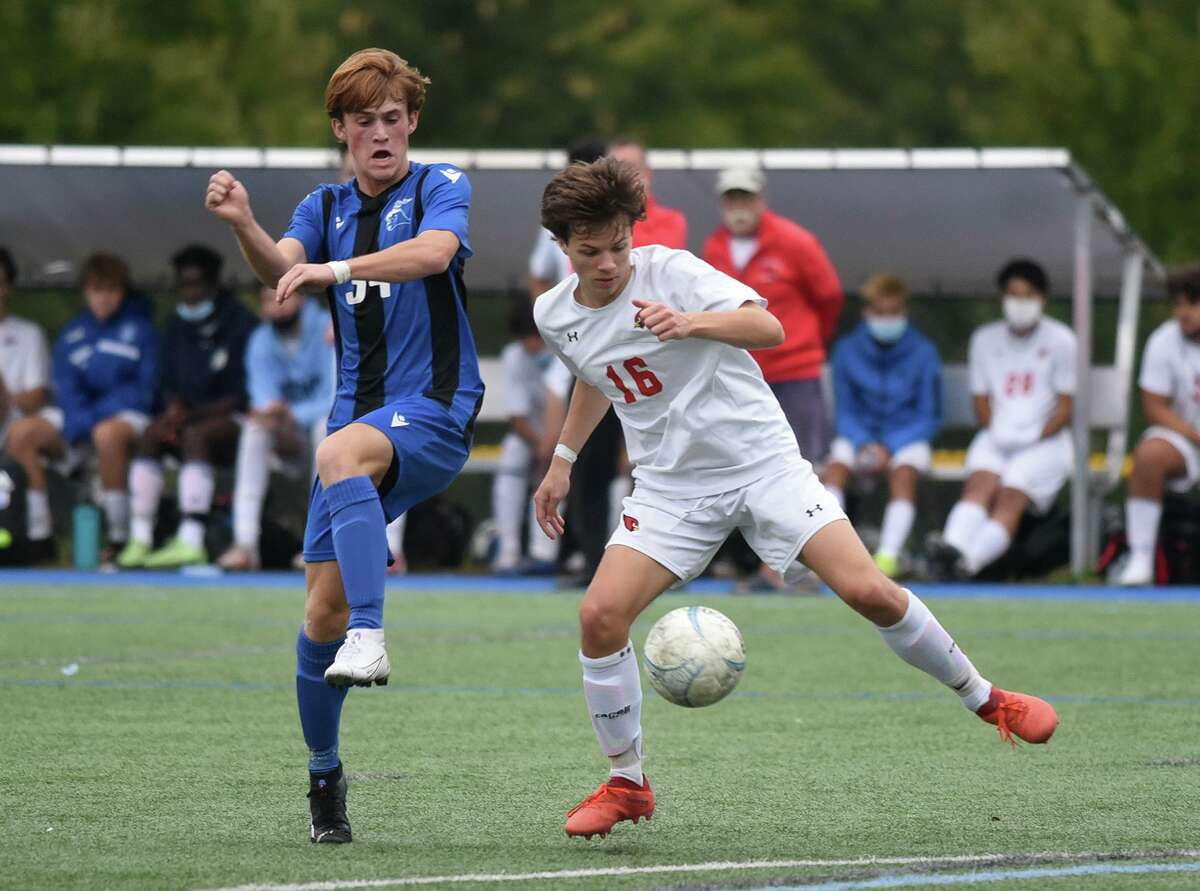 Greenwich's Gordon Cartwright (16) controls the ball while Darien's Matthew Kennedy (34) defends during a boys soccer game at Darien High School on Tuesday, Oct. 5, 2021.