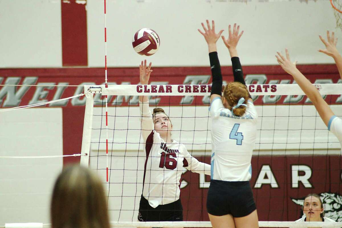 Clear Creek's Stratton Sneed (16) tries to hit a shot over Brazoswood's Olivia Stringer (4) Tuesday at Clear Creek High School.