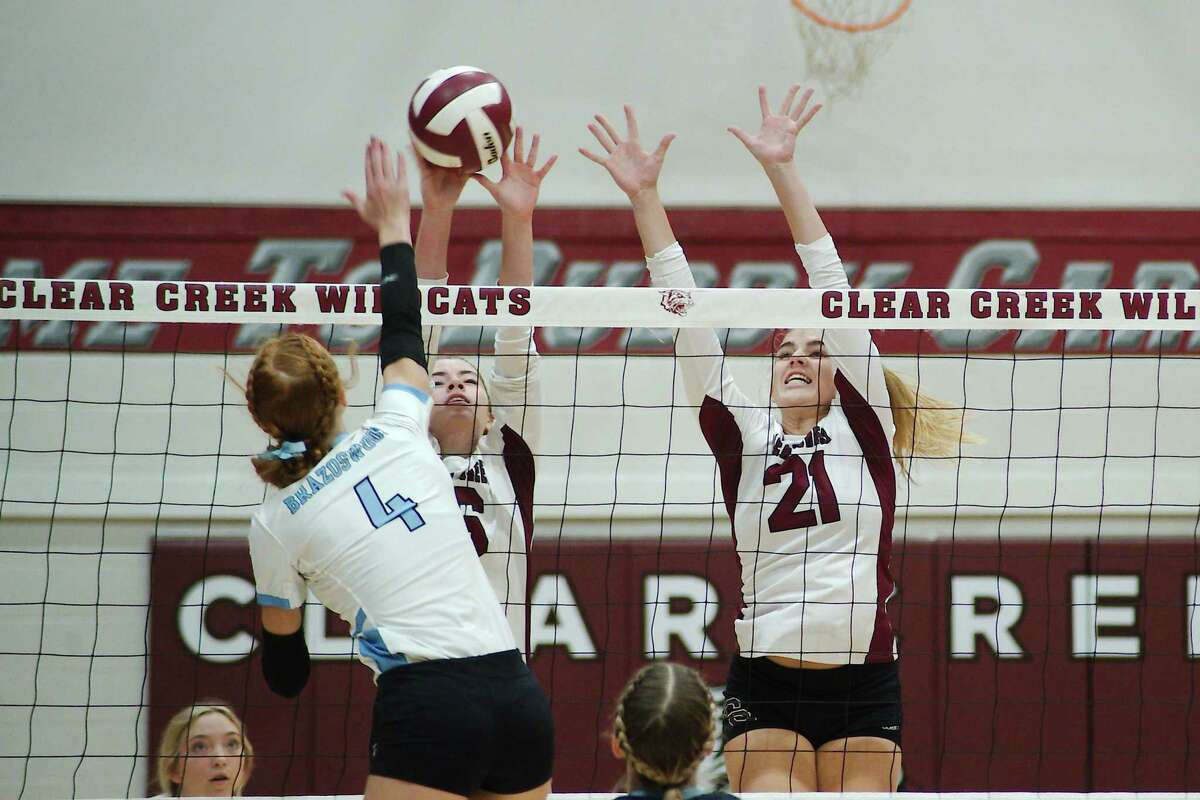 Clear Creek's Stratton Sneed (16) and Melody Herrin (21) try to block a shot from Brazoswood's Olivia Stringer (4) Tuesday at Clear Creek High School.