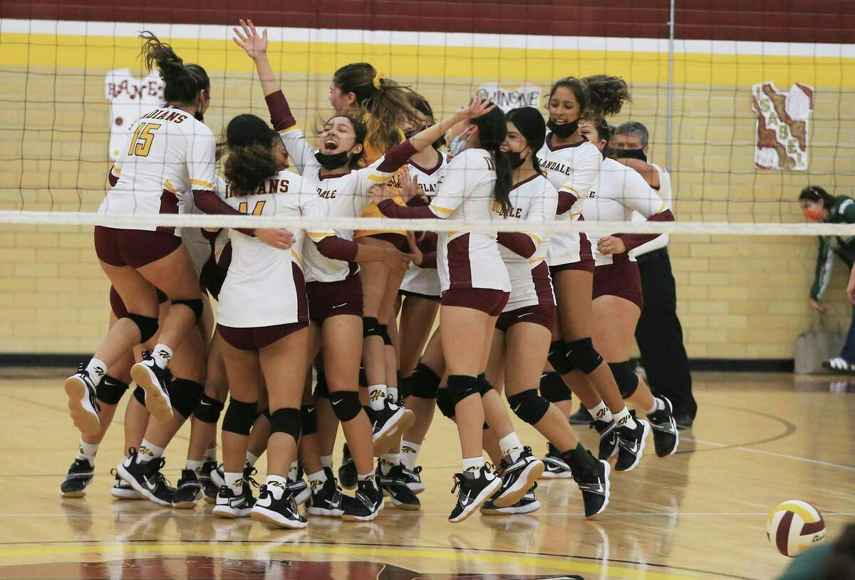 The Harlandale volleyball team celebrates after its final point against McCollum during a volleyball match on Tuesday, Oct. 5, 2021. Harlandale took the victory in three straight sets.