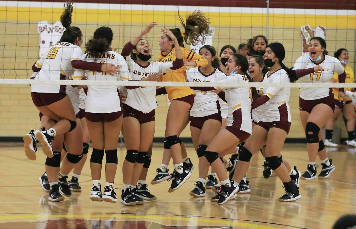The Harlandale volleyball team celebrate its final point against McCollum during their volleyball match on Tuesday, Oct. 5, 2021. Harlandale took the victory in three straight sets.