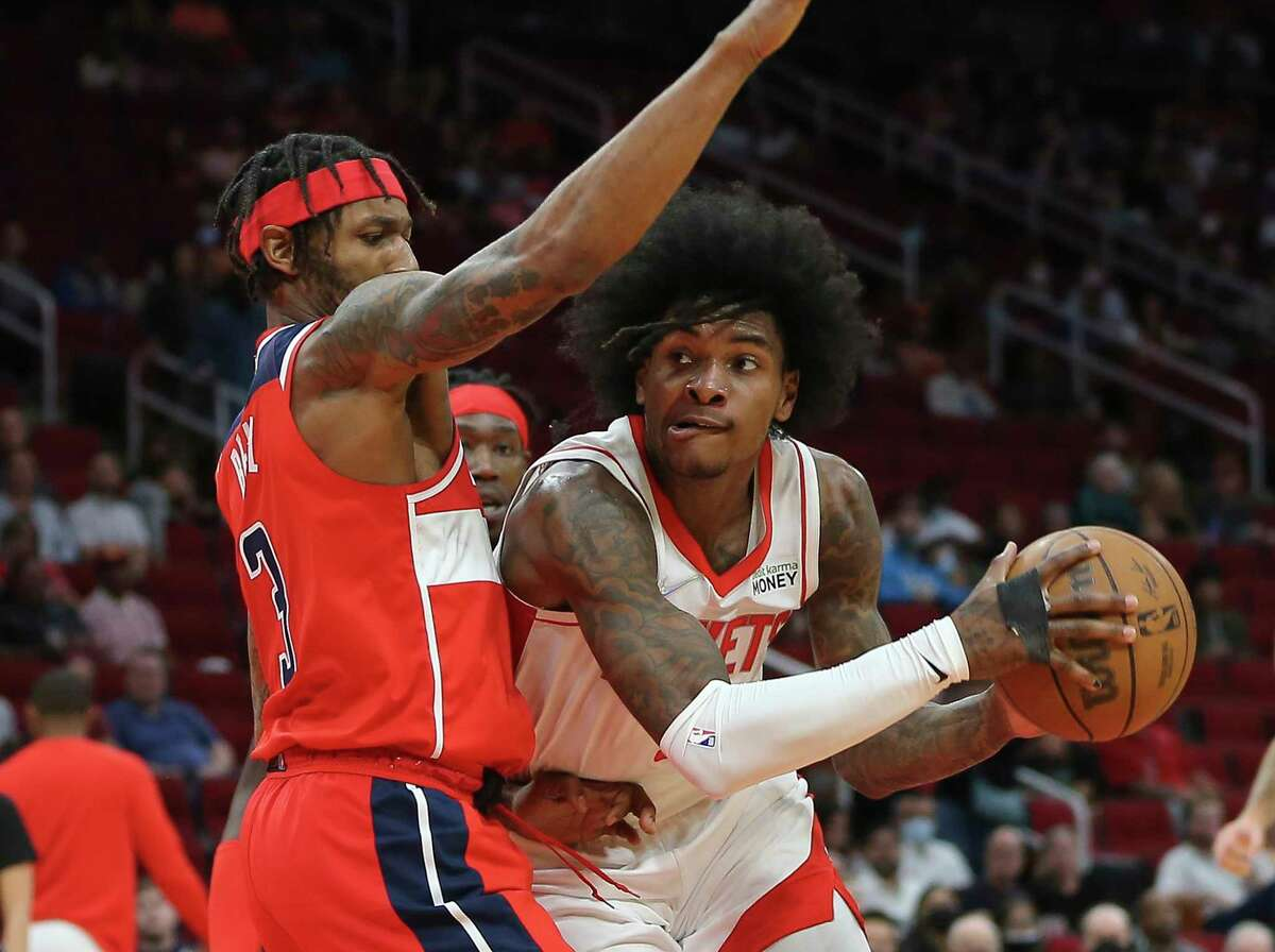 Houston Rockets guard Kevin Porter Jr. (3) drives toward the basket against Washington Wizards guard Aaron Holiday (3) during the second quarter of the NBA game Tuesday, Oct. 5, 2021, at Toyota Center in Houston.
