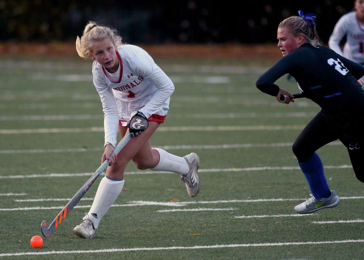 Greenwich's Zita Cohen (1) carries the ball during the Cardinals' field hockey game against Darien in Greenwich on Friday, Oct. 30, 2020.