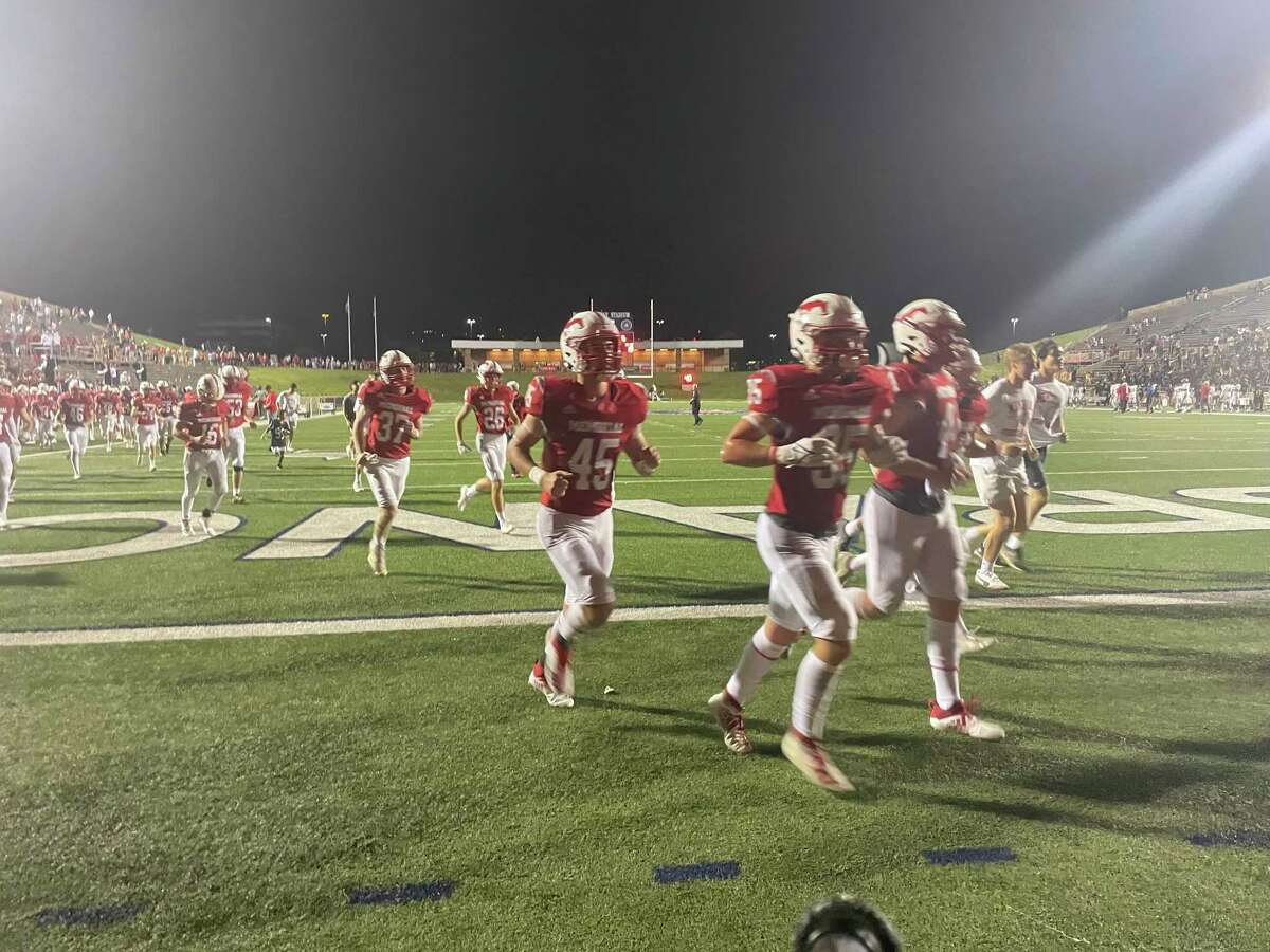 The Memorial Mustangs run off the field following their 41-6 win over Spring Woods on Oct. 1 at Tully Stadium.