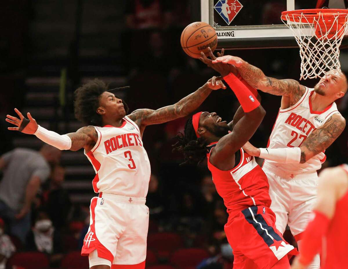 Houston Rockets center Daniel Theis (27) blocks Washington Wizards forward Montrezl Harrell (6) during the first half of the NBA game Tuesday, Oct. 5, 2021, at Toyota Center in Houston.