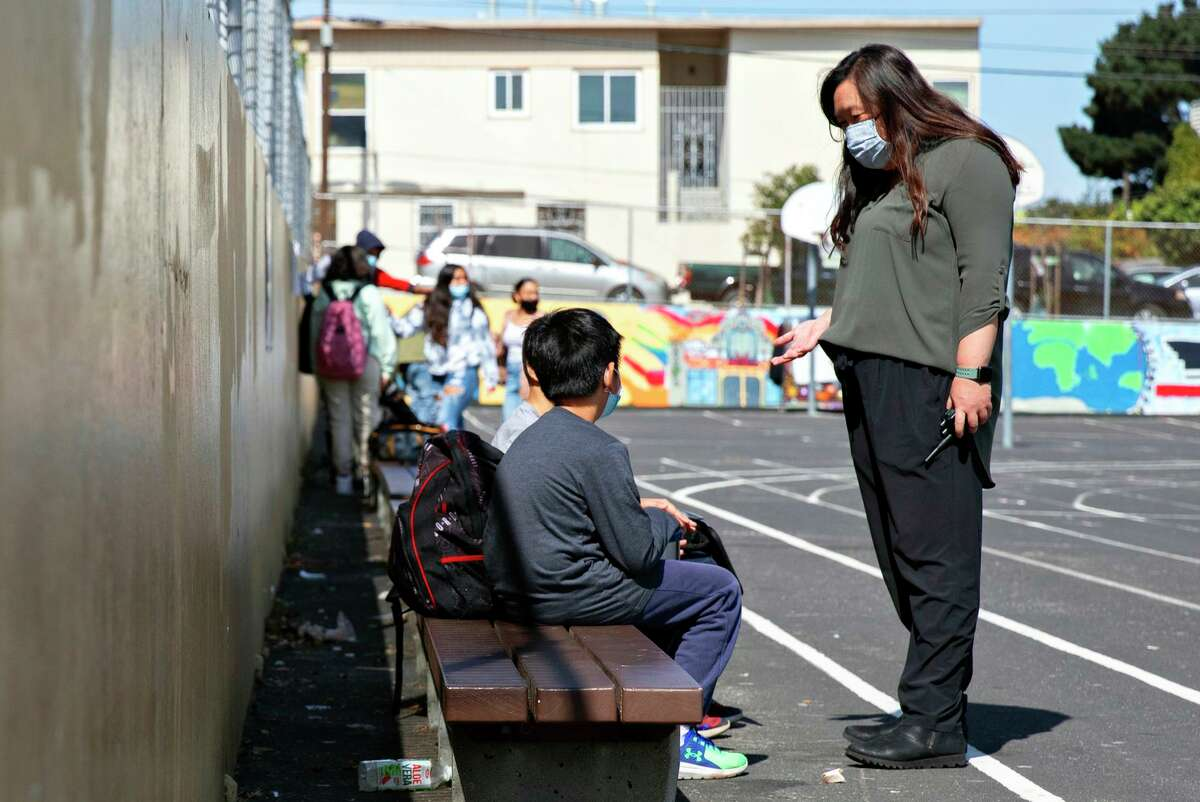 Counselor Leslie Hu helps resolve a conflict between two students as she walks the yard during lunchtime at Dr. Martin Luther King Jr. Academic Middle School in San Francisco.