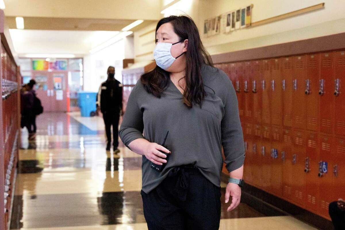 Counselor Leslie Hu walks the yard and checks in with students during lunchtime at Dr. Martin Luther King Jr. Academic Middle School in San Francisco. Hu is seeing the fallout from the pandemic play out on the playground and in classrooms.