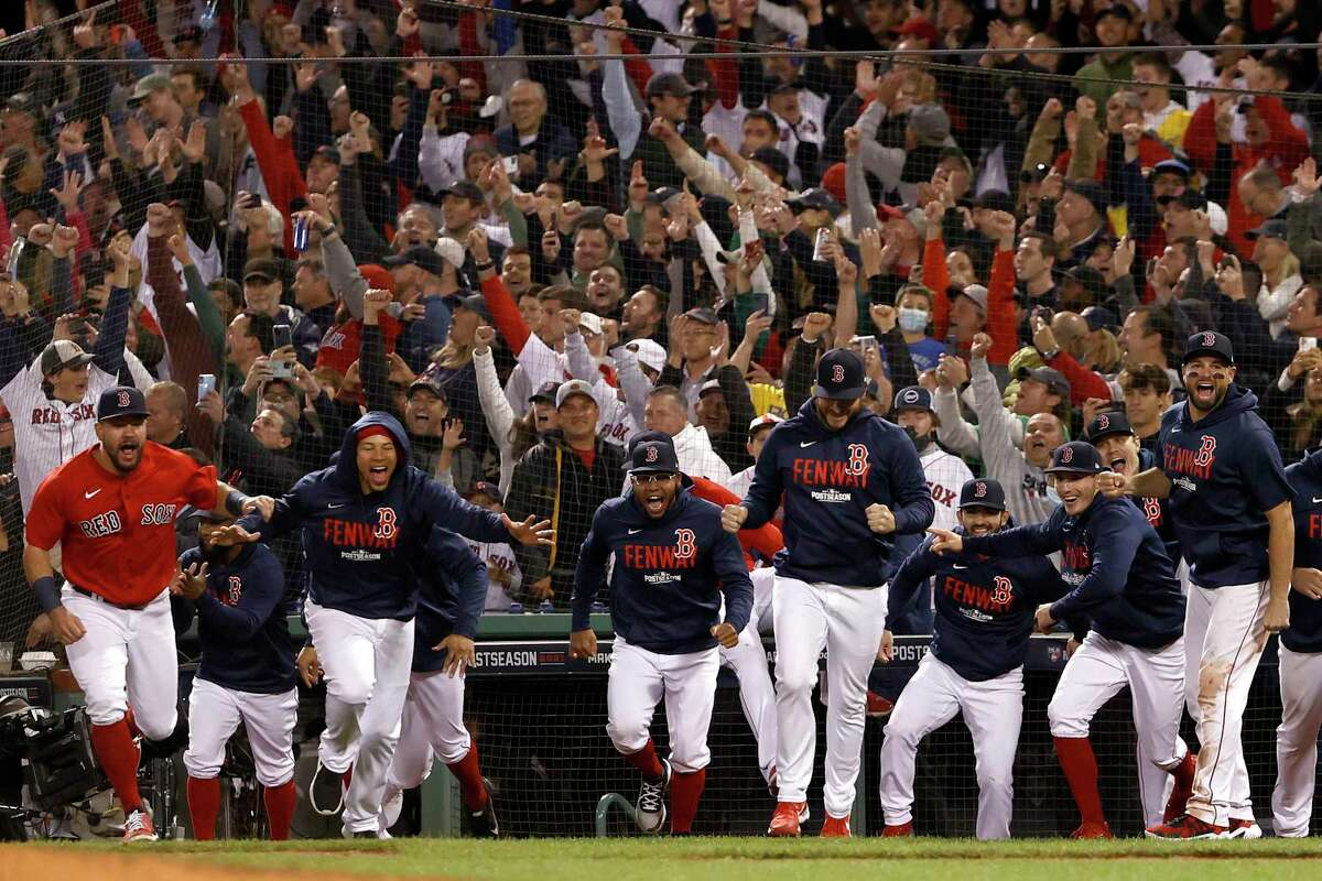 BOSTON, MASSACHUSETTS - OCTOBER 05: The Boston Red Sox celebrate after beating the New York Yankees 6-2 in the American League Wild Card game at Fenway Park on October 05, 2021 in Boston, Massachusetts. (Photo by Winslow Townson/Getty Images)