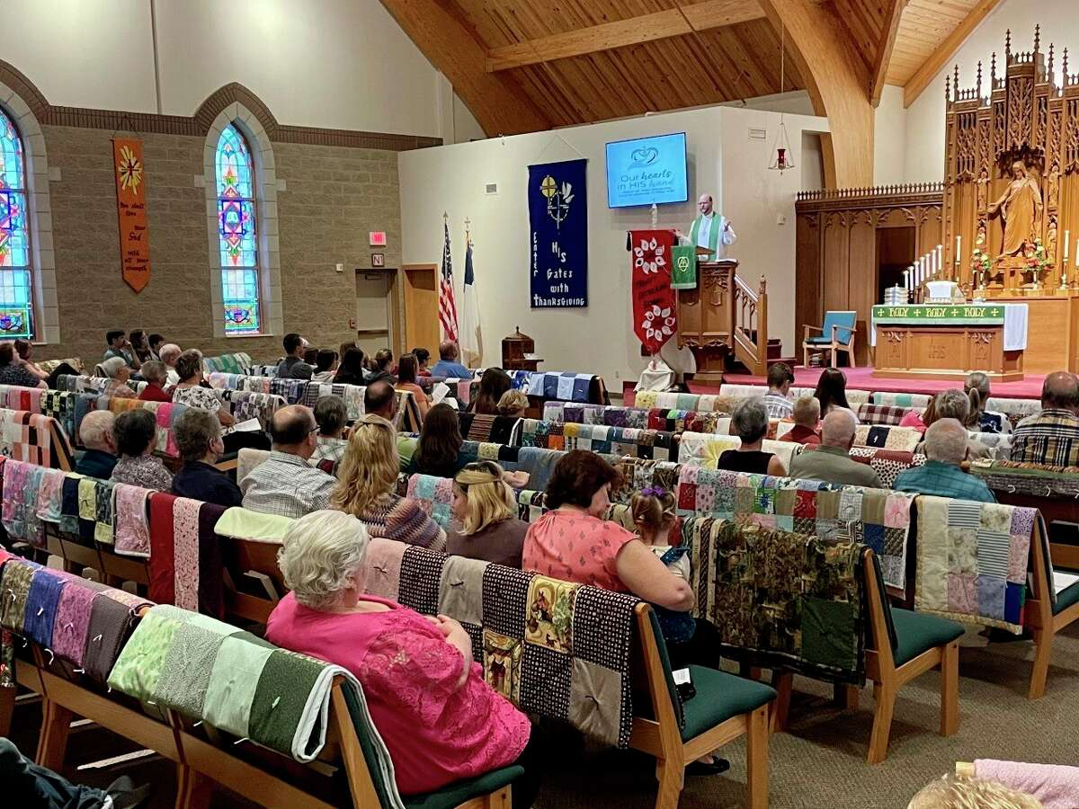 """Quilts made by theLutheranWomen's MissionaryLeaguewere on display during the Trinity Lutheran Church """"LWML Sunday"""" service on Oct. 3. The handmade quilts are distributed each year to several local charitable organizations. (Submitted photo)"""