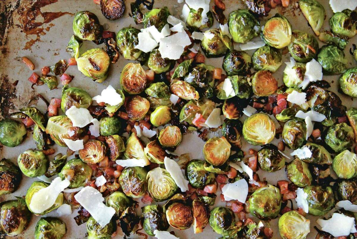 """Roasted Brussels sprouts add pancetta for Brussels Sprouts and Pancetta Pasta from """"Sheet Pan Suppers"""" by Molly Gilbert"""