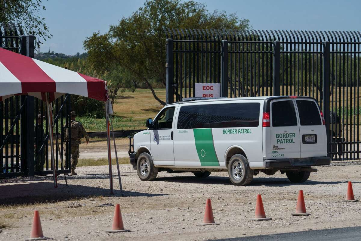A U.S. Border Patrol van enters a gate to the area under the Del Rio-Ciudad Acuna International Bridge where about 15,000 mostly Haitian migrants were waiting to enter the United States, in Del Rio, Texas on Sept. 25, 2021.