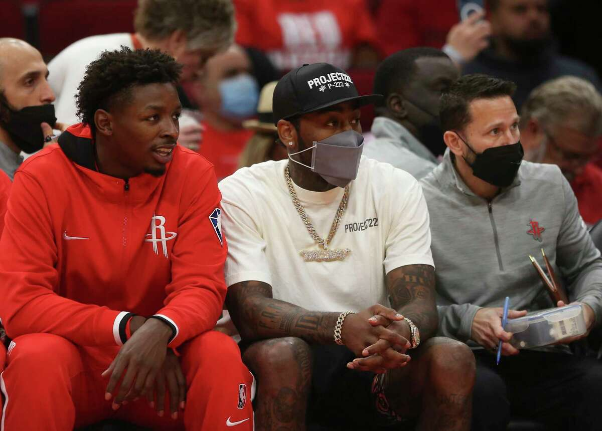 Houston Rockets guard John Wall (1) watches the first half NBA game against the Washington Wizards from the sideline Tuesday, Oct. 5, 2021, at Toyota Center in Houston.