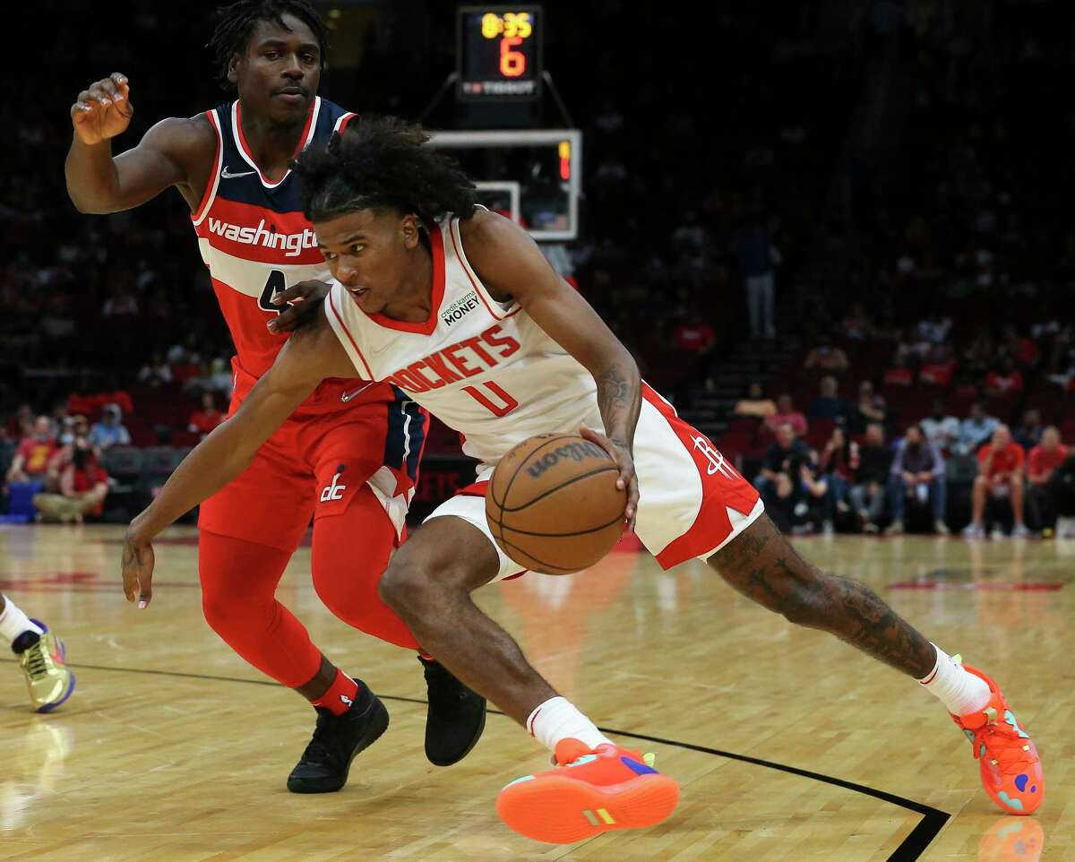 Houston Rockets guard Jalen Green (0) dribbles while Washington Wizards guard Aaron Holiday (4) is guarding during the second quarter of the NBA game Tuesday, Oct. 5, 2021, at Toyota Center in Houston.
