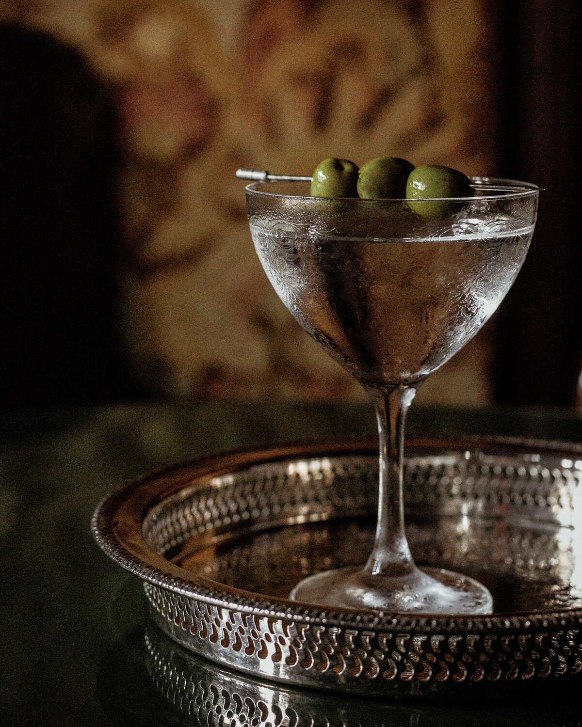 The elements to a martini are simple - vodka or gin, vermouth, garnish - but the cocktail itself is far from simple. A mixologist from Hudson's Maker Hotel shares tips for making James Bond-worthy martinis at home.