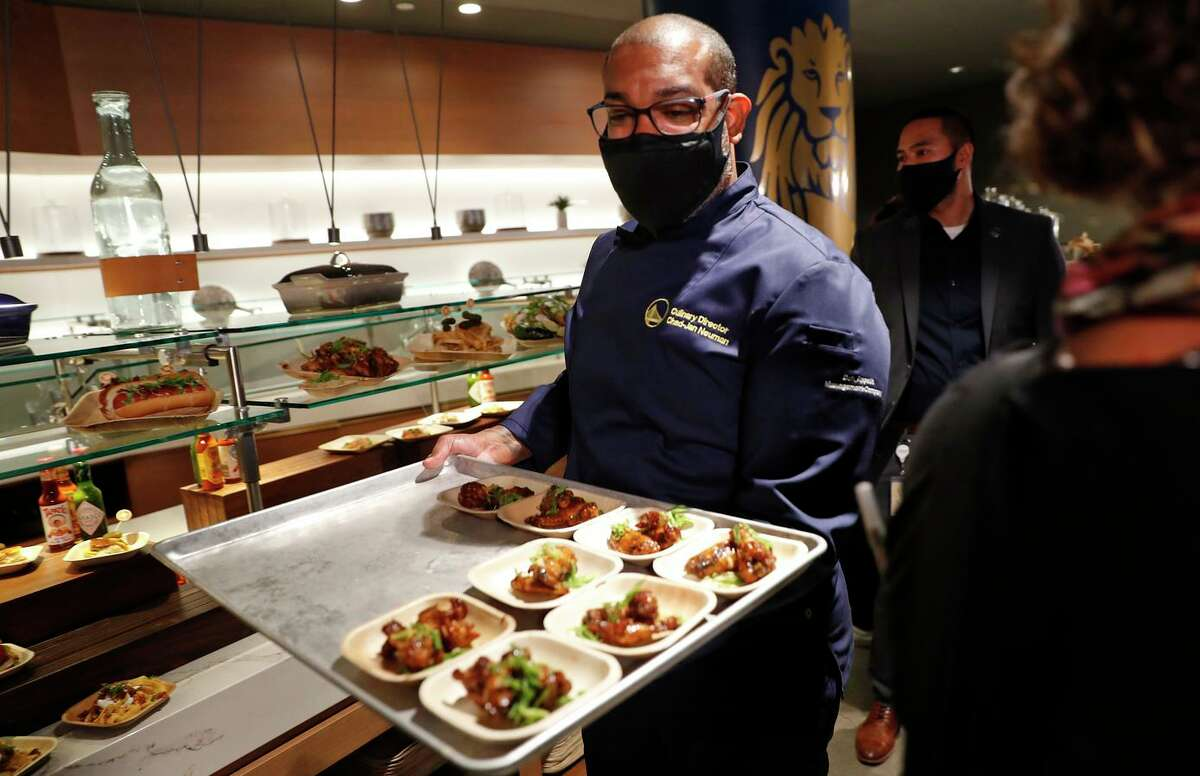 Culinary Director Chad Neuman serves samples during a preview of new Chase Center food and drink options for the 2021-22 season on Tuesday, Oct. 5, 2021.