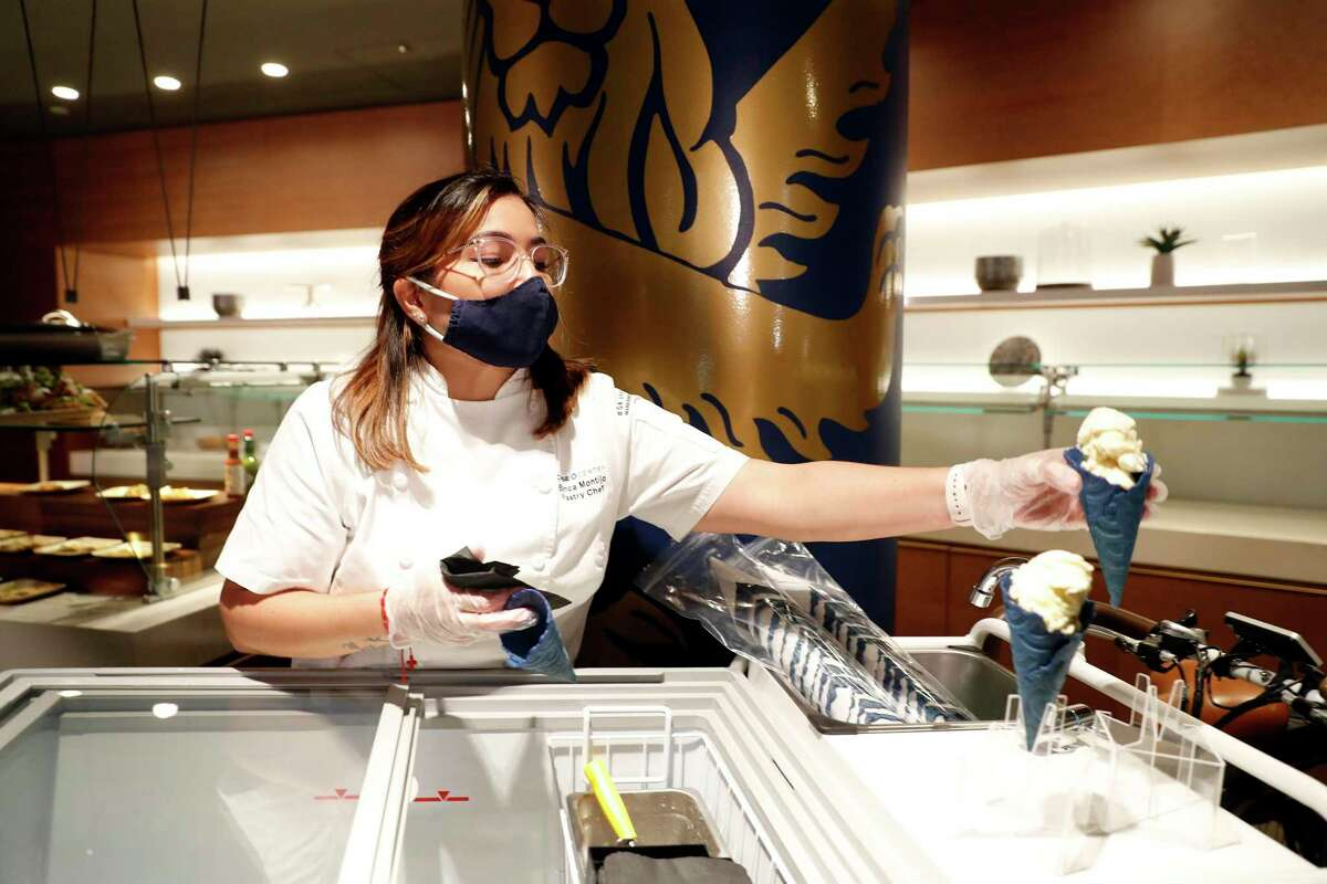 Senior pastry chef Bianca Montijo scoops ice cream cones during a preview of new Chase Center food and drink options on Tuesday, Oct. 5, 2021.