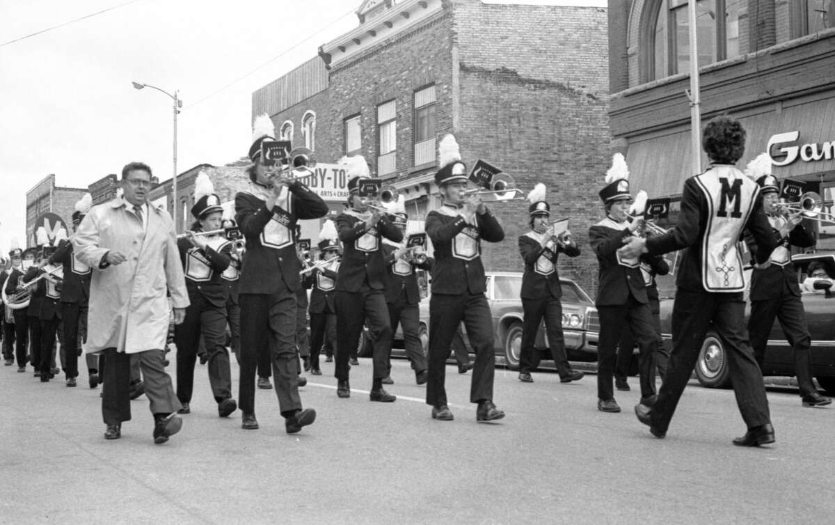 Here is a scene showing the Manistee High School Band marching down River Street during the 1981 homecoming parade. (Manistee County Historical Museum photo)