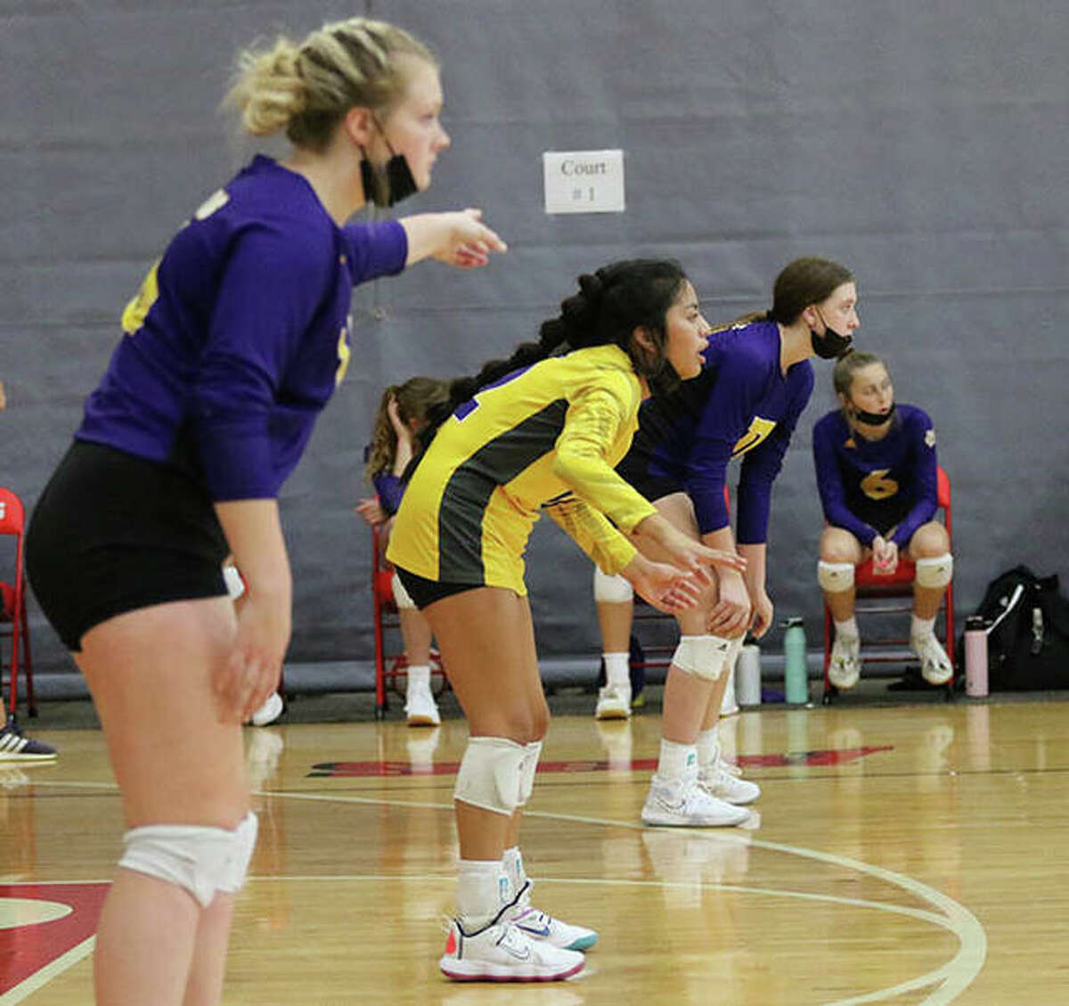 CM's back row with (from left) Emily Williams, Ella Middleton and Lauren Dunlap await serve during a match in the Alton Tourney on Sept. 11 in Godfrey. On Tuesday, CM lost a MVC match to Waterloo in Bethalto.